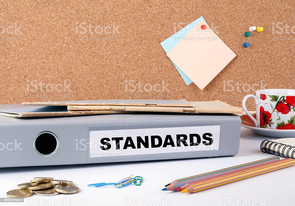Standards - folder on white office desk. stock photo