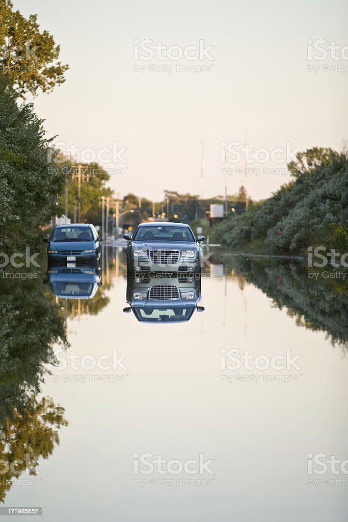 standed vehicles on a flooded road stock photo