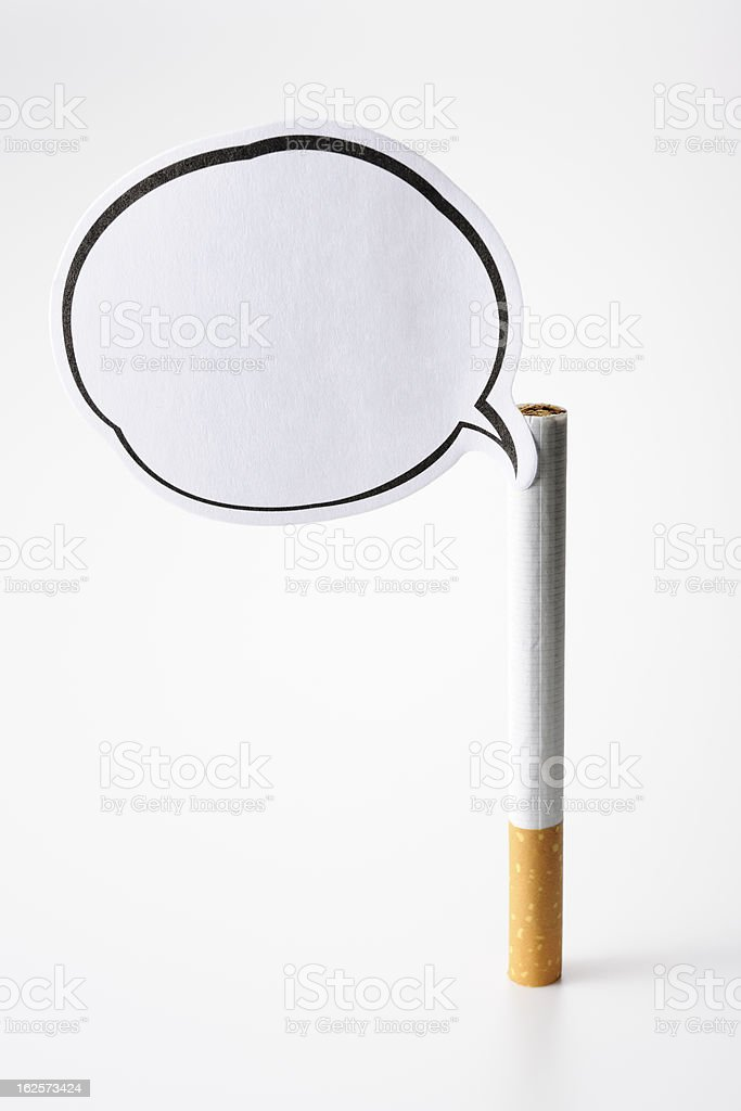 Standing a cigarette with blank speech bubble on white background royalty-free stock photo