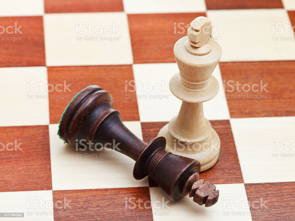 standing and fallen chess kings royalty-free stock photo