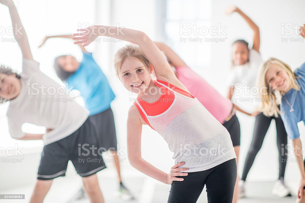Standing and Stretching During PE stock photo