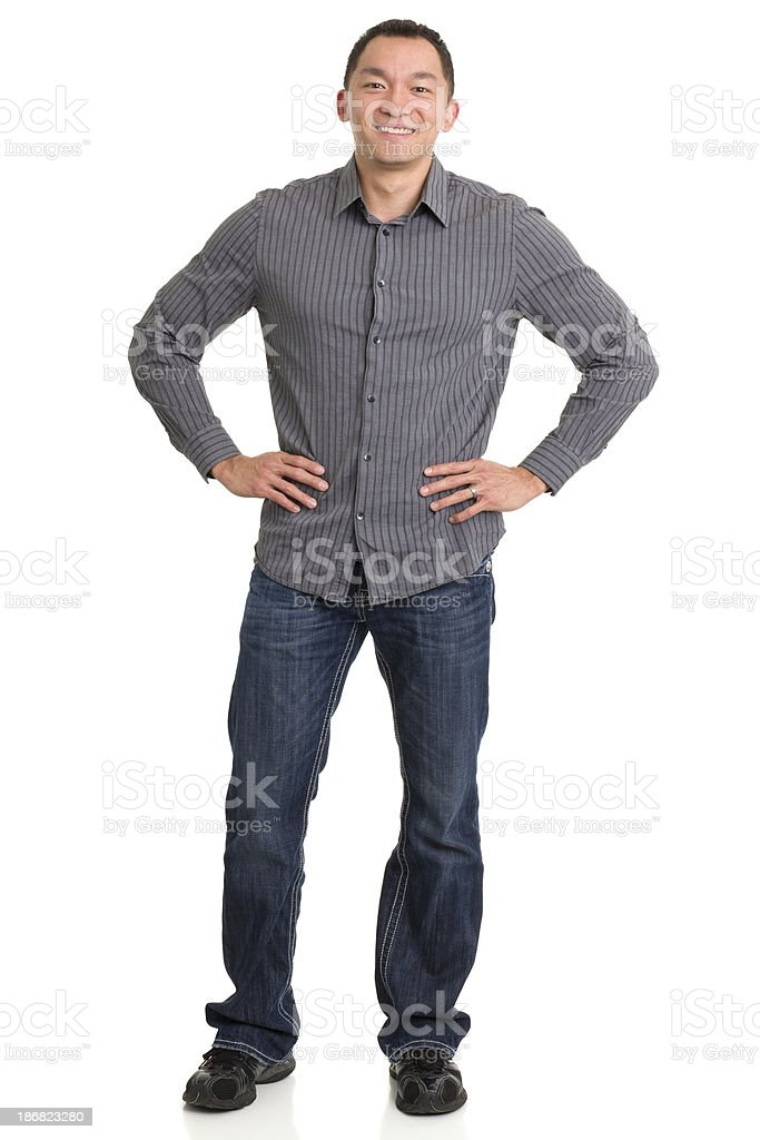 Standing Asian Man With Arms Akimbo stock photo