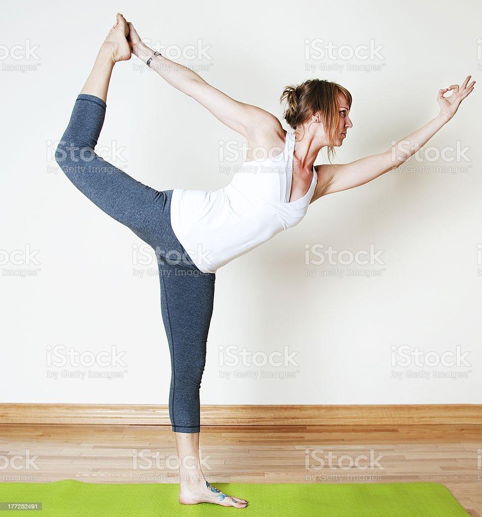 Standing Bow Yoga Pose - Dandayamana Dhanurasana stock photo