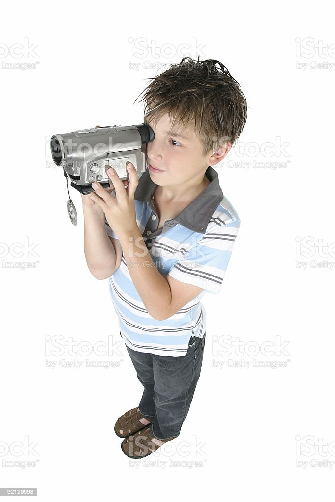 Standing boy using a digital video camera royalty-free stock photo