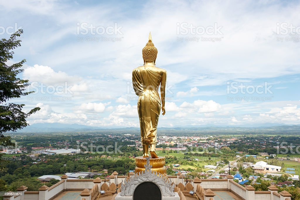 Standing Buddha sculpture stock photo