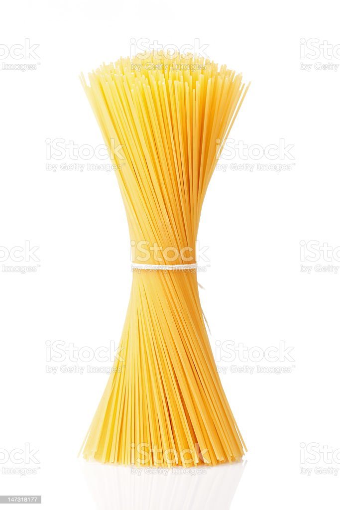 Standing bunch of spaghetti tied in white string stock photo