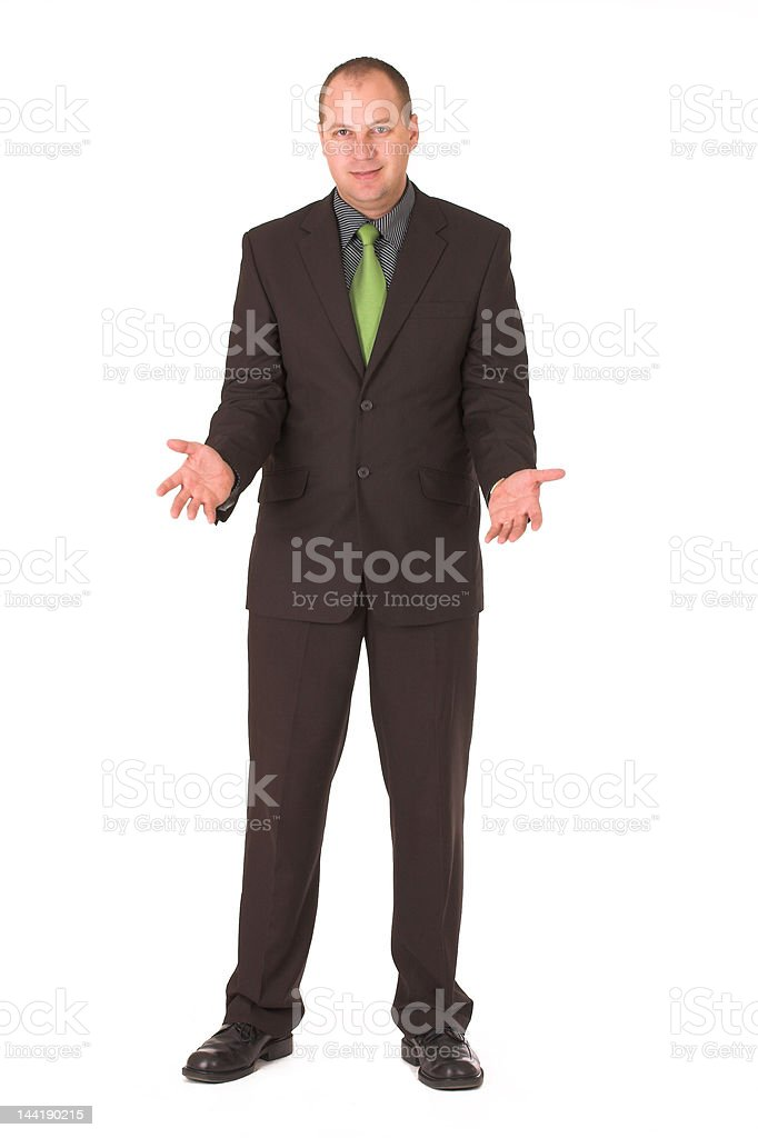 Standing businessman in black suit with open hands royalty-free stock photo