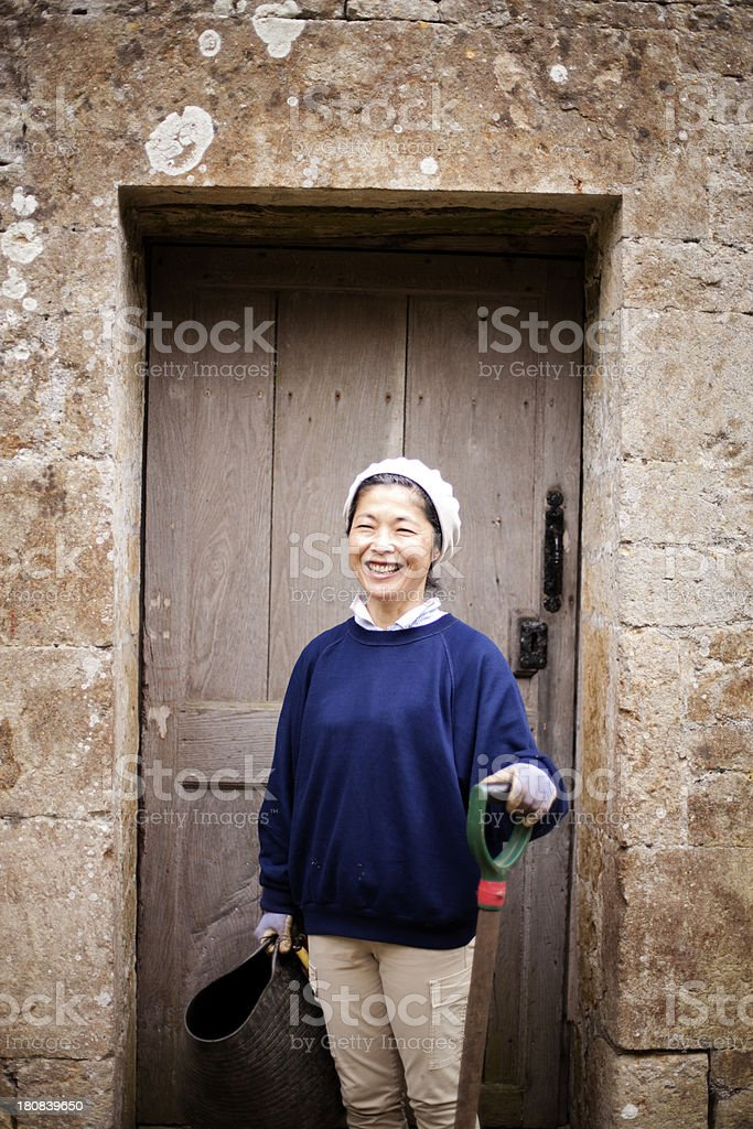 Standing by country house doorway stock photo