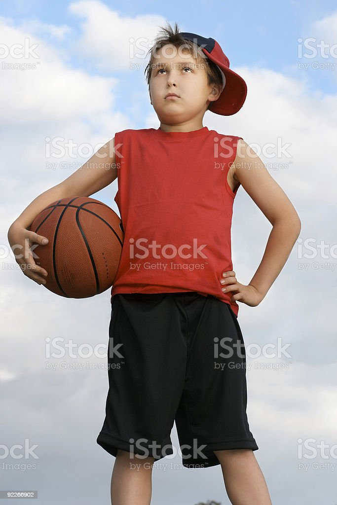 Standing child holding a basketball royalty-free stock photo