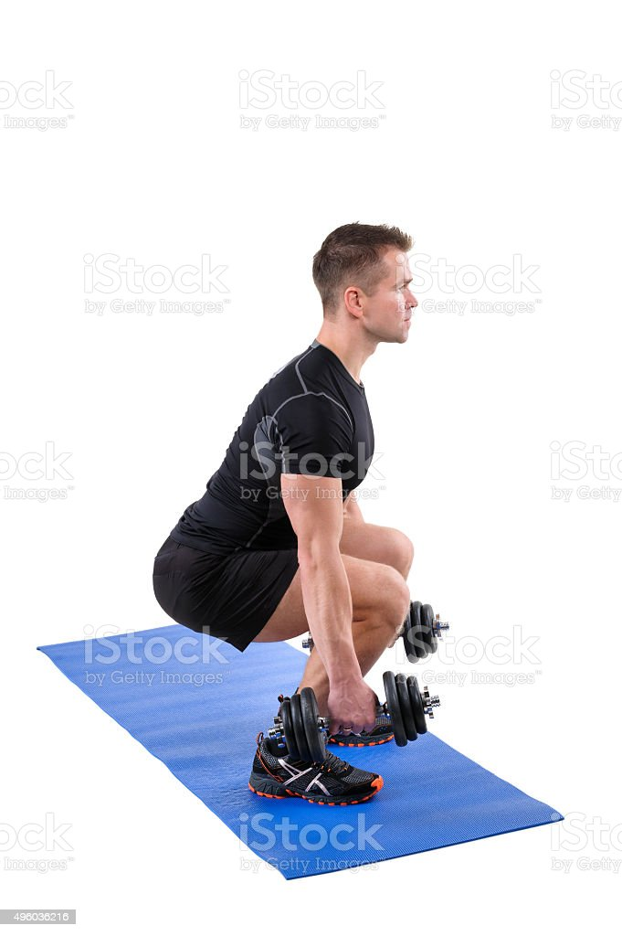 Standing Dumbbell Calf Raise or Squats workout stock photo