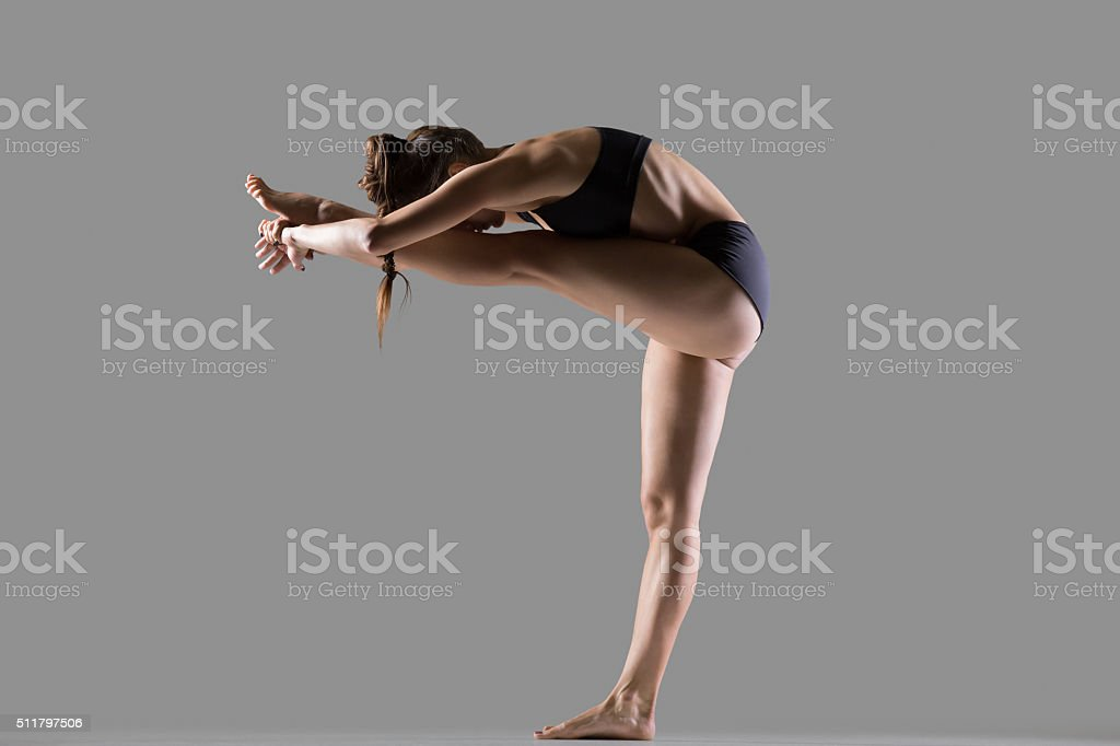 Standing Head to Knee Yoga Pose stock photo