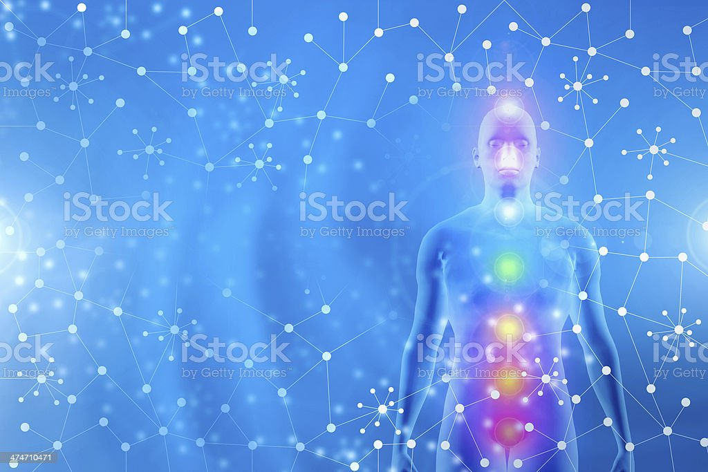 Standing human body meditating, chakra energy points, blue abstract background stock photo