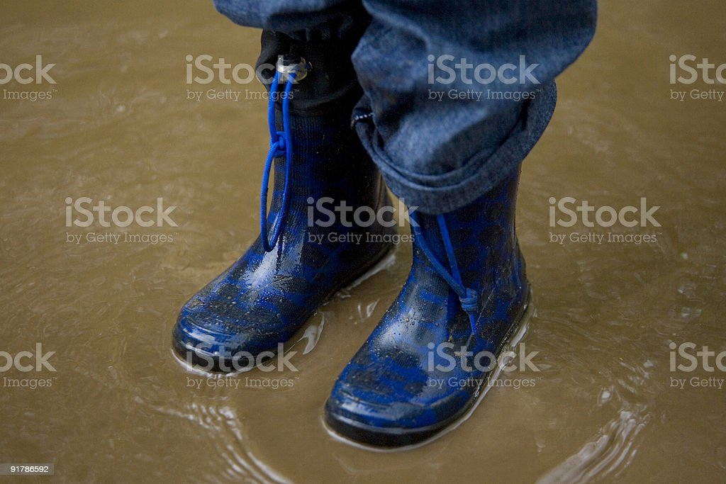 Standing In a Muddy Puddle royalty-free stock photo