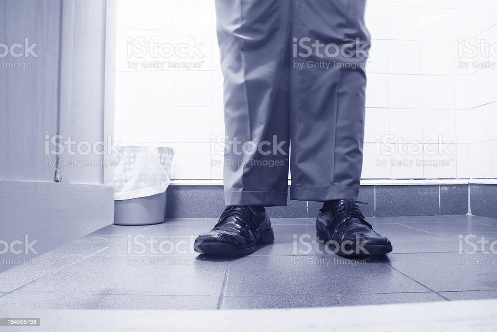 standing in the bathroom 1950's 1960's style stock photo