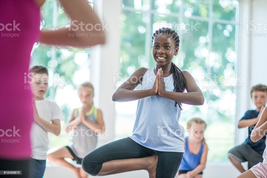 Standing in Tree Pose stock photo