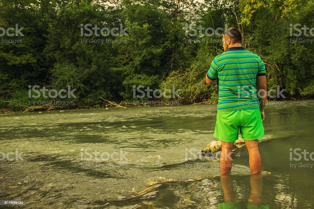 Standing in water stock photo