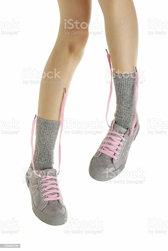 Standing legs in sport shoes stock photo