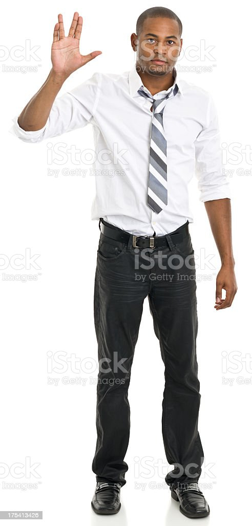 Standing Man Gives Vulcan Salute stock photo