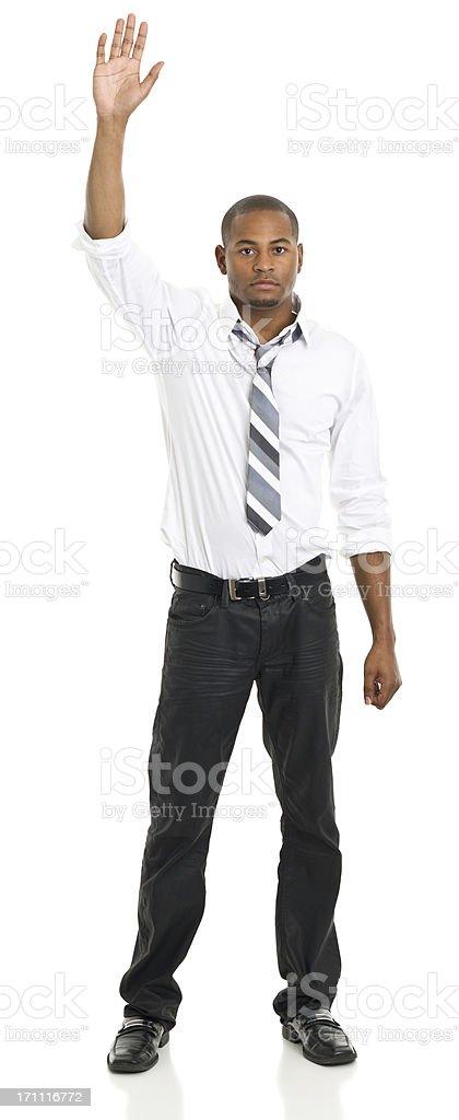 Standing Man Raises Hand stock photo