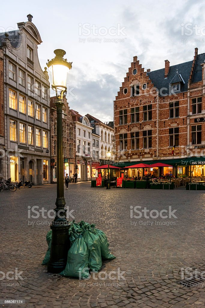 Standing next to garbage bags of street lights in Bruges stock photo