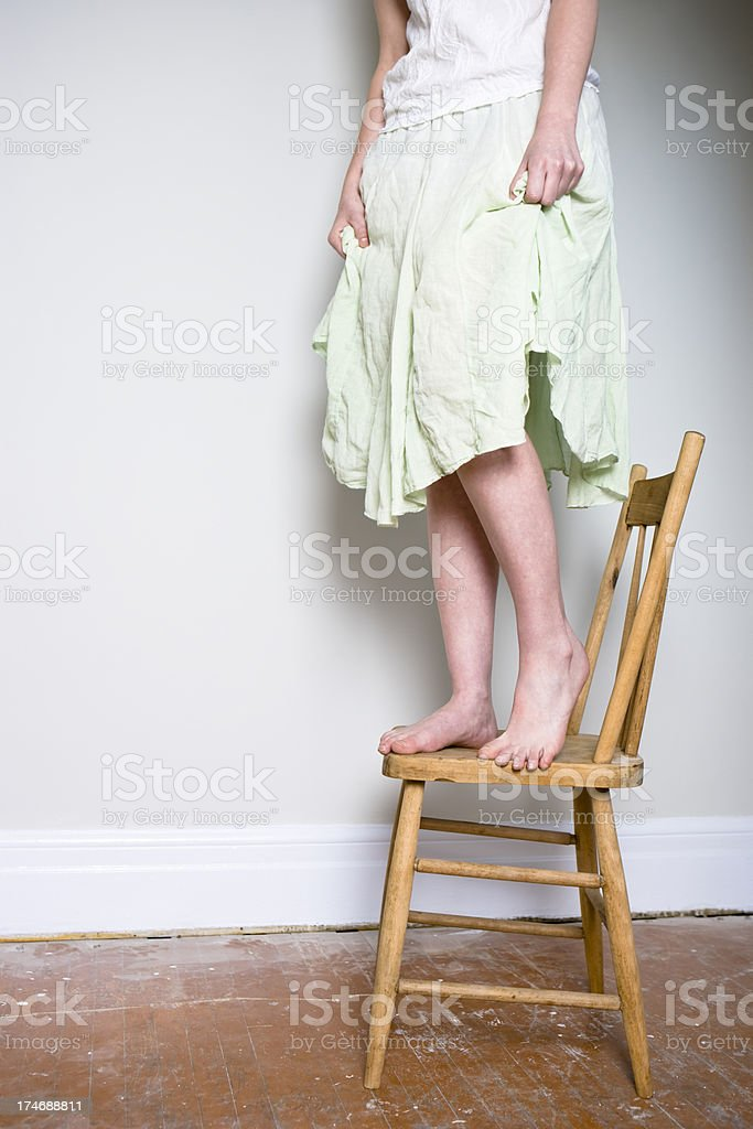 Standing on a Chair royalty-free stock photo