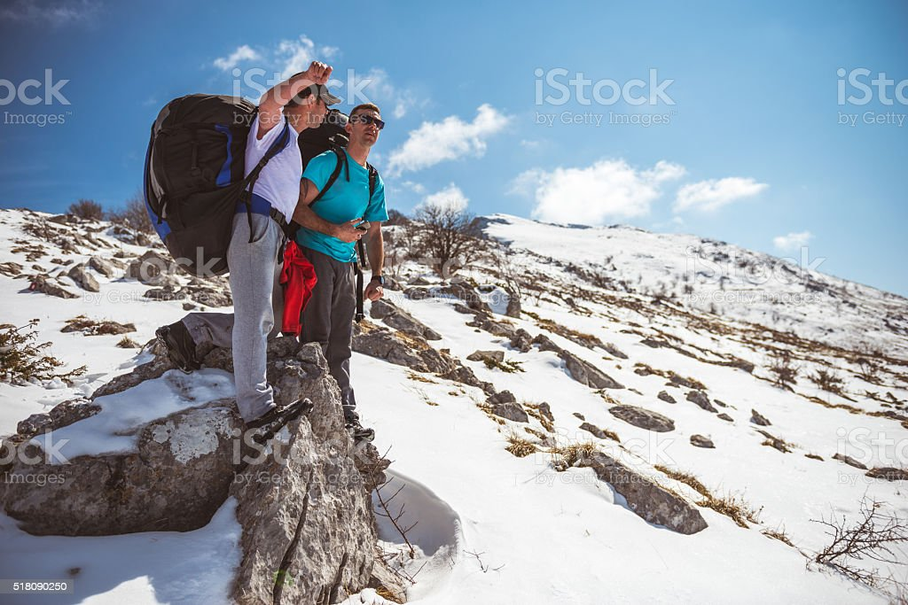 Standing on a mountain top stock photo