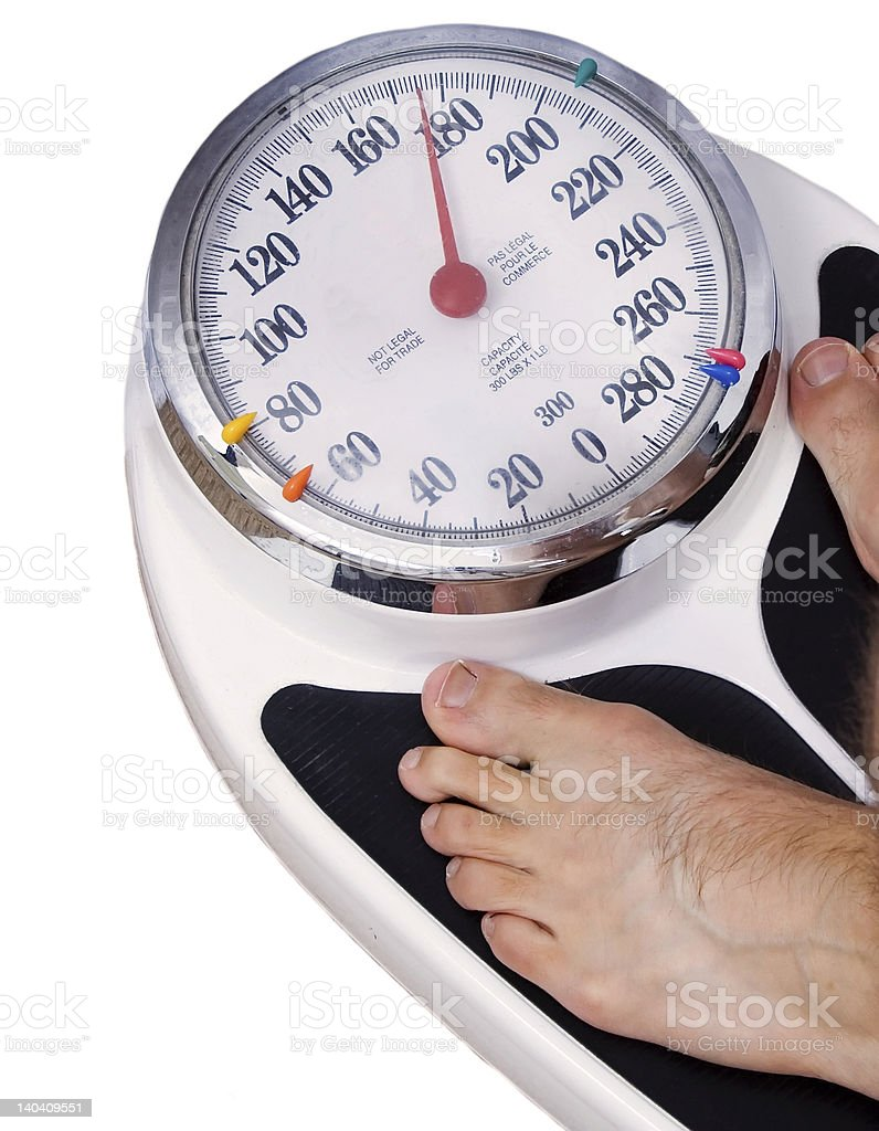 Standing on a scale royalty-free stock photo