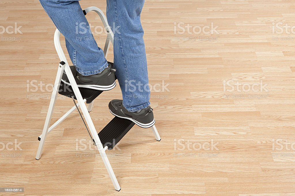 Standing on a Step Ladder stock photo
