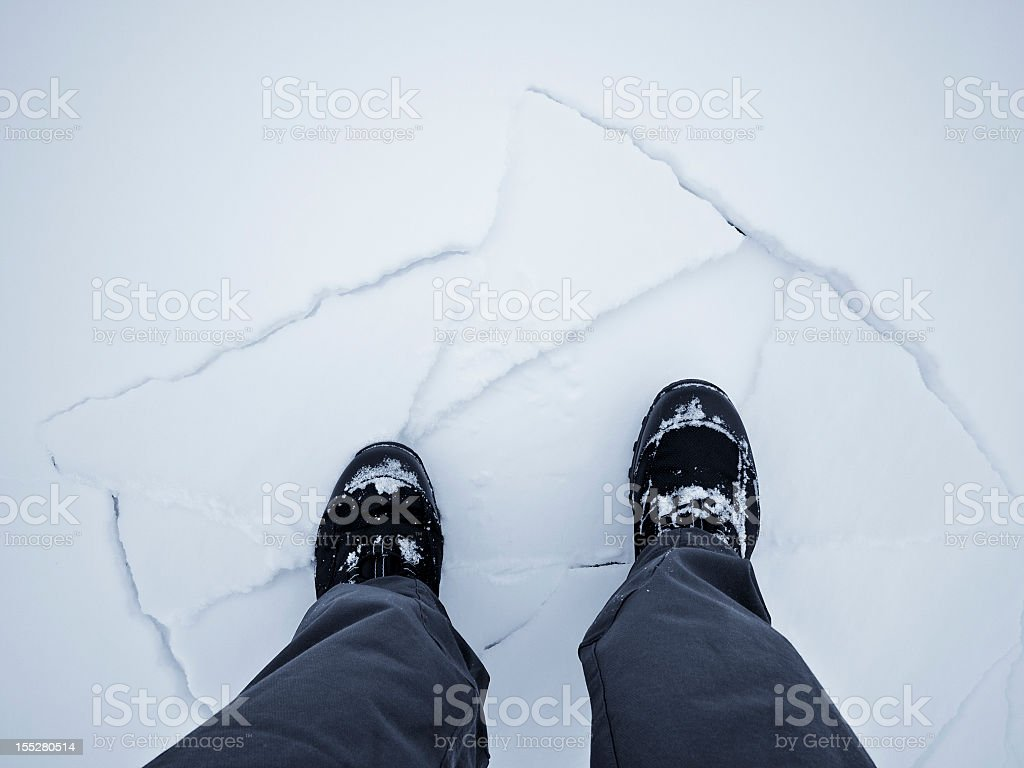 Standing On Broken Block Of Ice royalty-free stock photo