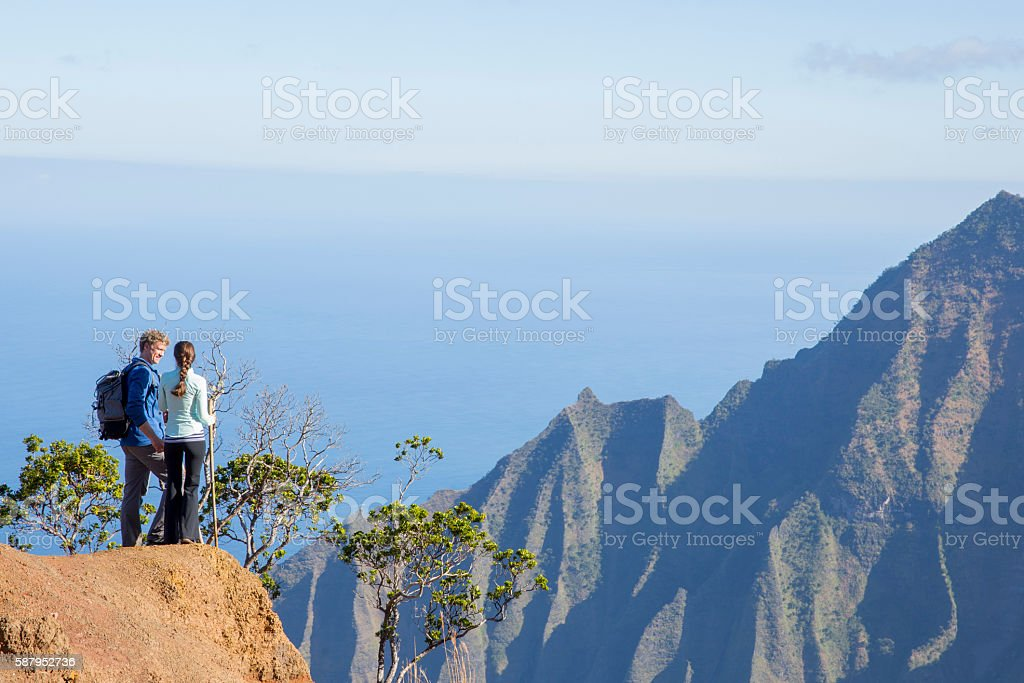 Standing on the Edge of the Mountain stock photo
