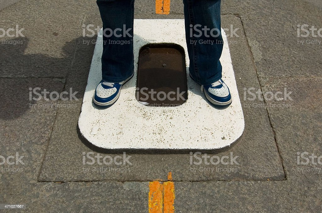 Standing on the Equator stock photo