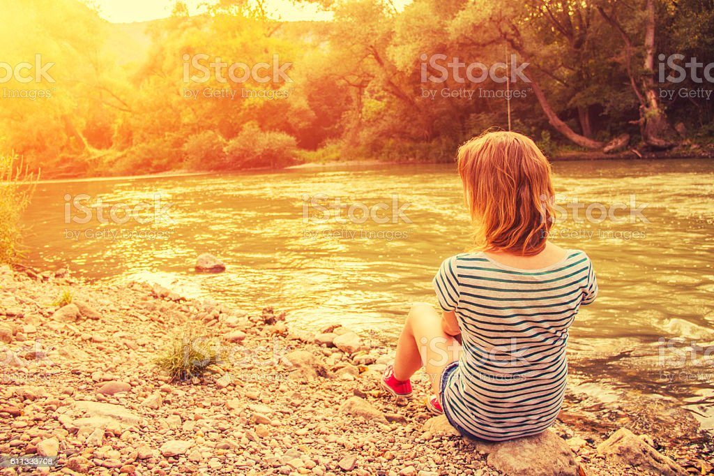 Standing on the river shore royalty-free stock photo