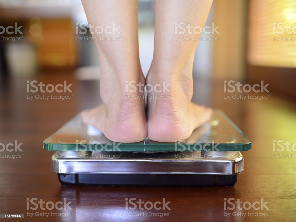 Standing On Weight Scale royalty-free stock photo