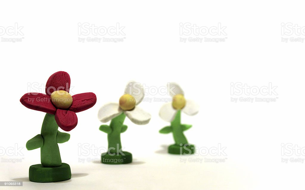 standing out concept with plasticine model flowers stock photo