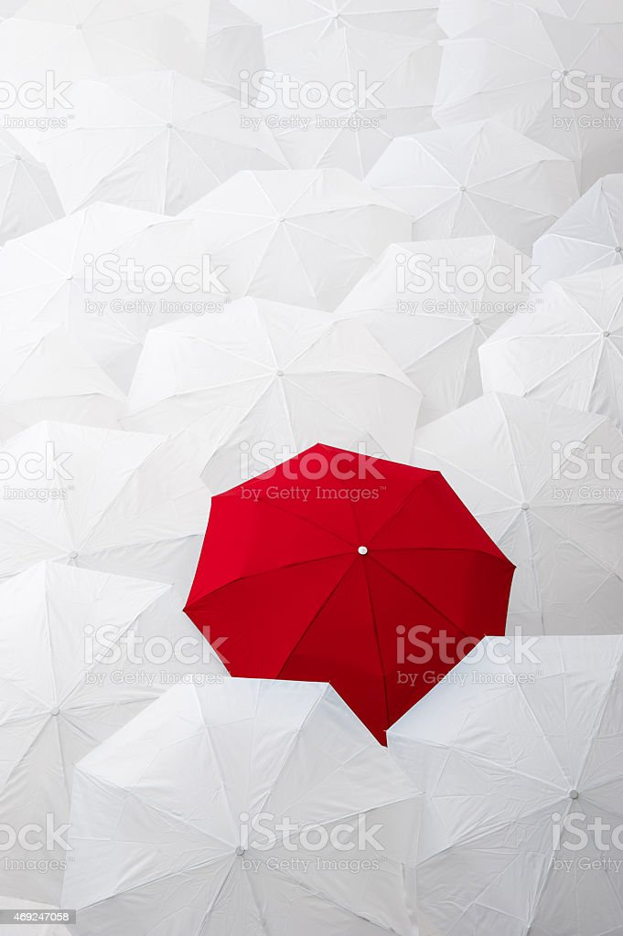 Standing out from the crowd. stock photo