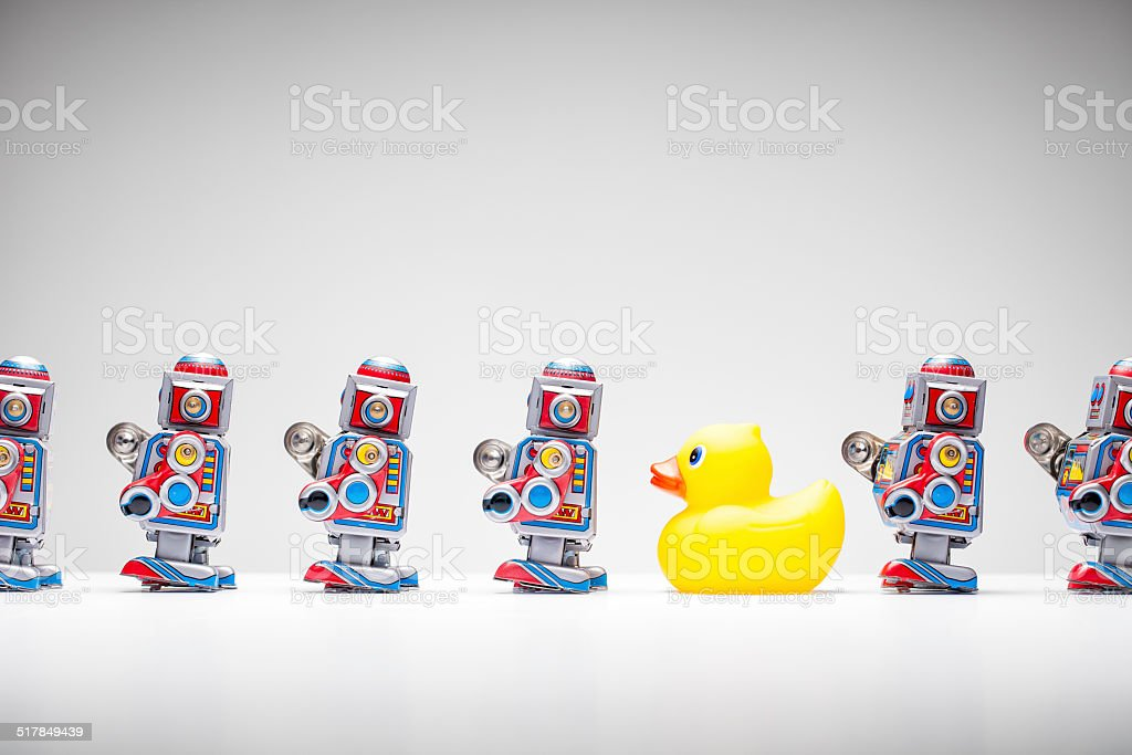 Standing out from the crowd - Tin Robot Rubber Duck stock photo