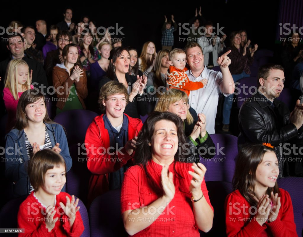 Standing Ovation in a Movie Theater royalty-free stock photo