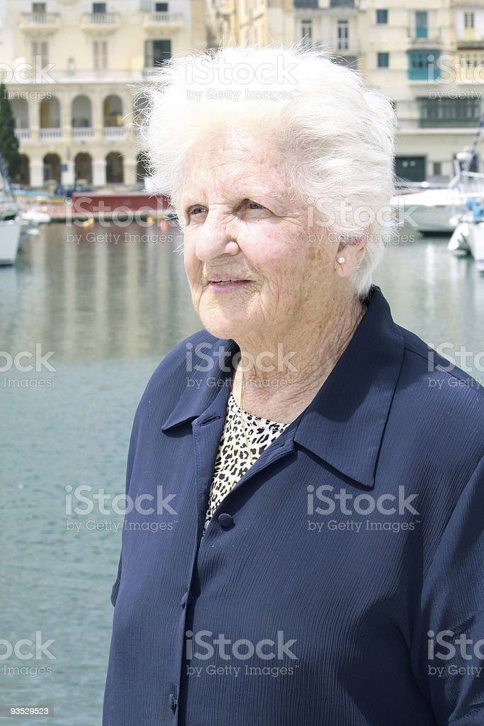standing portrait of and elderly lady stock photo