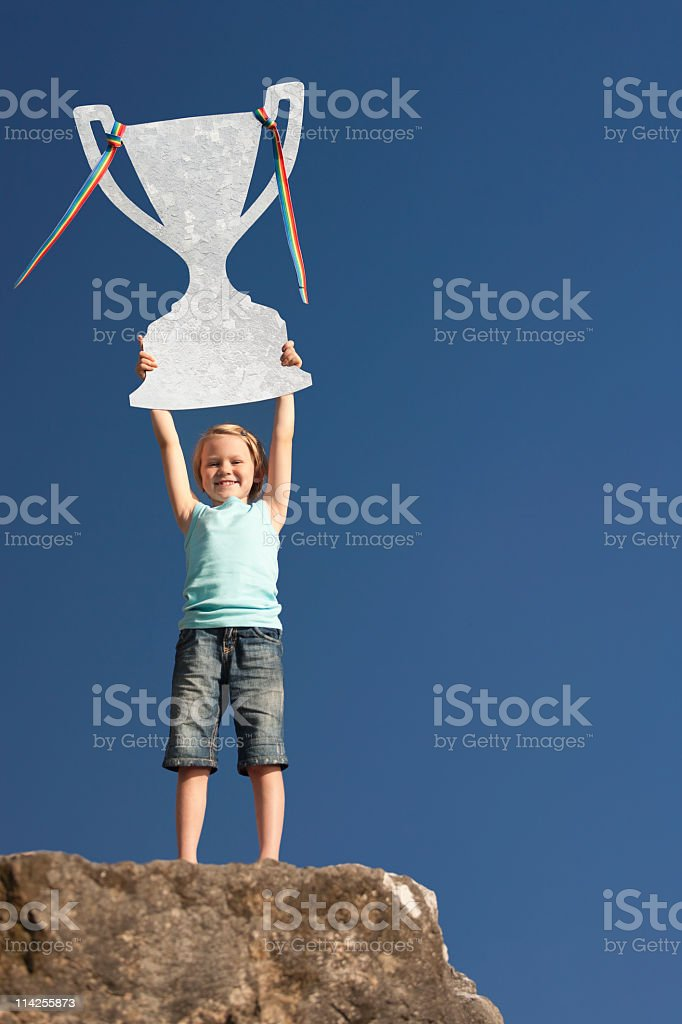 Standing proud with trophy in the air stock photo