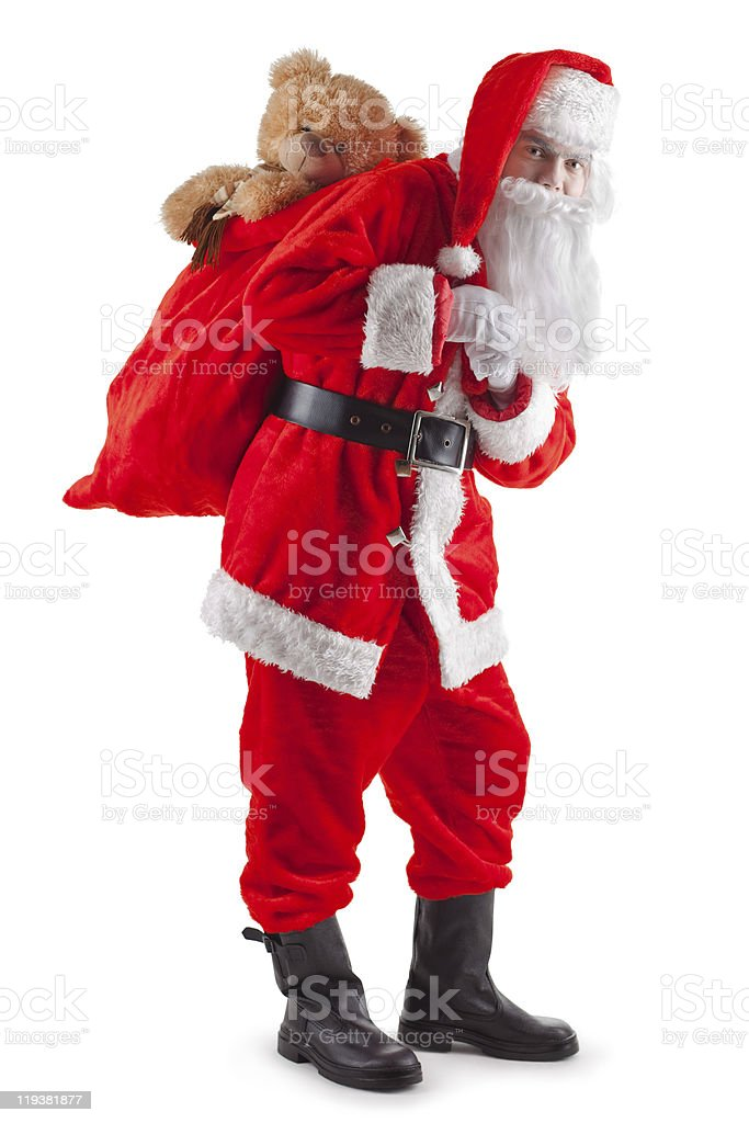Standing Santa with a bag of gifts royalty-free stock photo