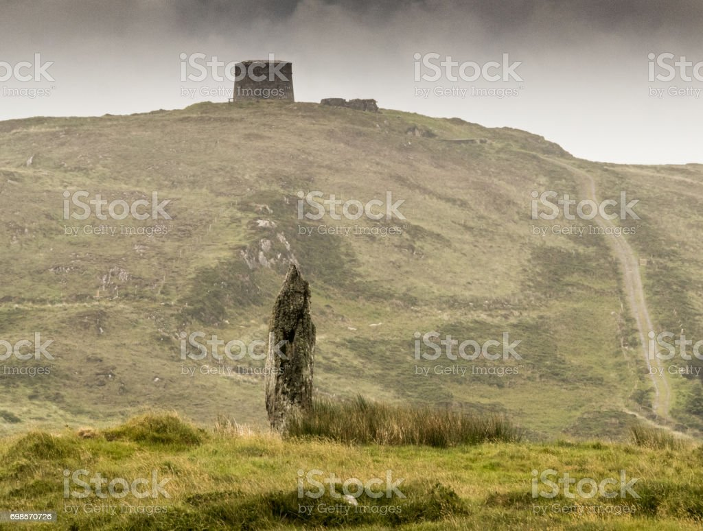 Standing Stone and Martello Tower stock photo