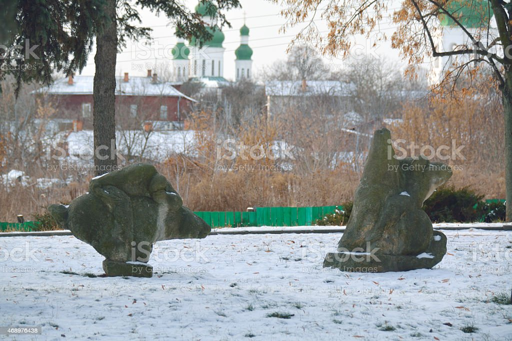 standing stone in Chernigiv with the church seen behind stock photo
