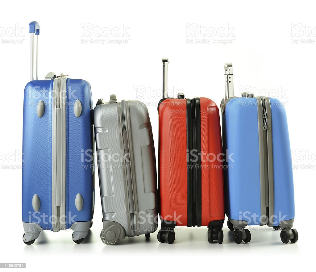 Standing suitcases in a line on white stock photo
