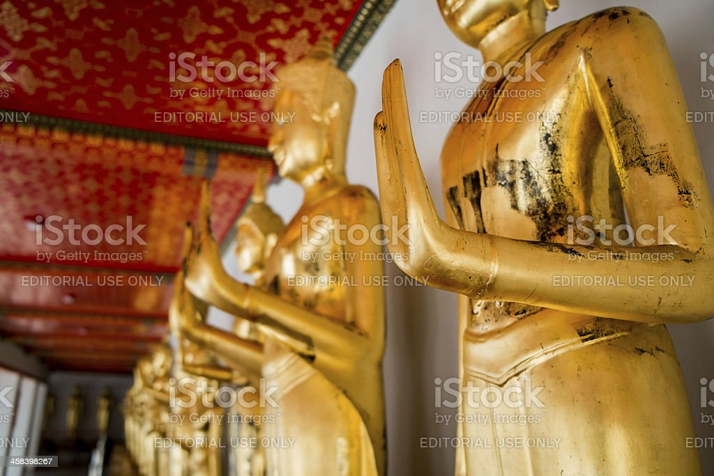 Standing Thai Golden Buddha from Wat Pho royalty-free stock photo