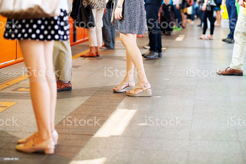 Standing thai people on BTS platform stock photo