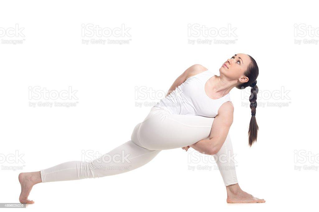 Standing twist exercise stock photo
