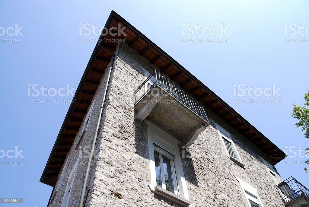 standing under a balcony viewed from the bottom up stock photo
