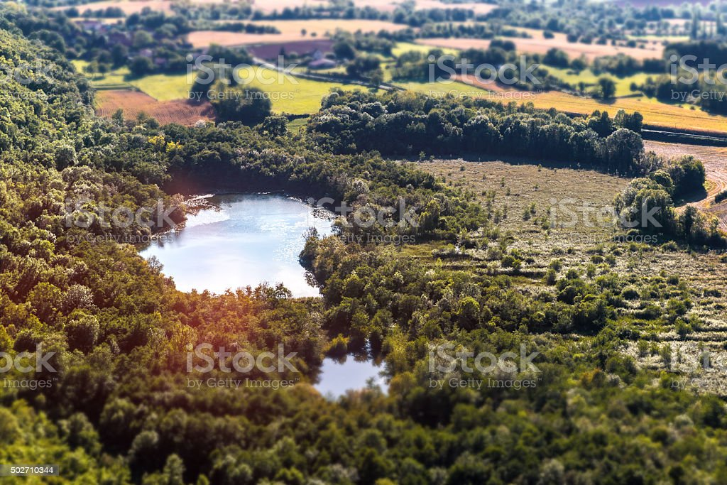 Standing water pond in french marsh aerial view landscape stock photo