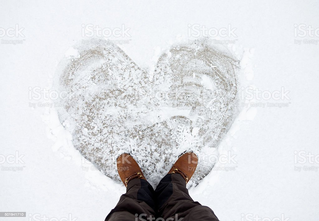 Standing with a heart shape stock photo