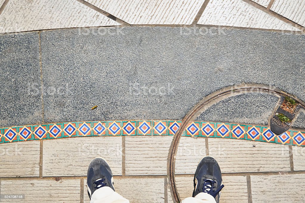 Standing, with my feet on a beautiful pavement stock photo